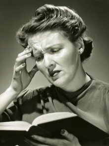 george-marks-woman-with-headache-while-reading